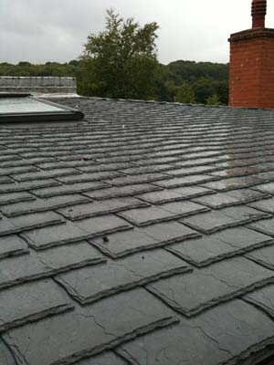 Low Pitched Eco Roof With Grey Slate Tiles
